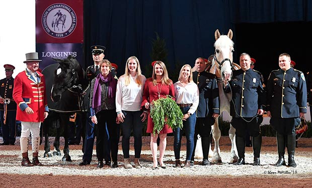 Pictured at the award ceremony, from left, John E. Franzreb III, Klinger, SFC Christopher Taffoya, Denise Quirk, Katherine Pinkard, Victoria Lowell, Emma Suarez-Murias, Sgt Russel Robar, Big D, Officer John Potter and Officer Eric Grove.