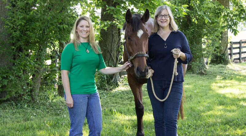 Researchers Karin Pekarchik, left, and Kimberly Tumlin are seeking information on those who participate in horse sports to learn more about the socioeconomic factors about the industry.
