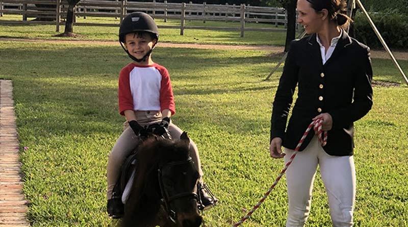 Jasper, 5, had his first riding lesson on Teddy.