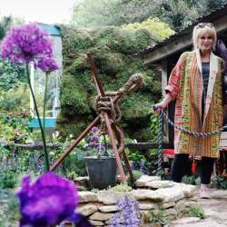 Joanna Lumley with Harley at The Donkey Sanctuary's 'Donkeys Matter' garden at the RHS Chelsea Flower Show in London. © RHS / Luke MacGregor