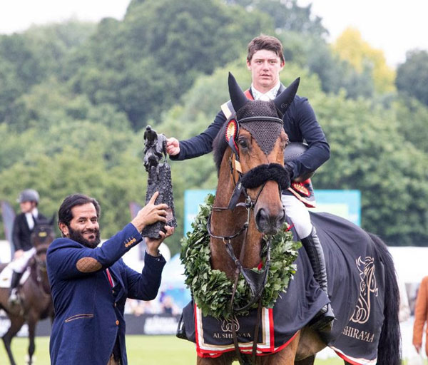 Michael Pender and Hearton Du Bois Halleeux with the Boomerang Trophy for winning the Al Shira'aa Derby at Hickstead.