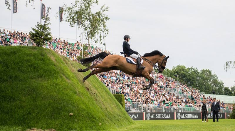 Michael Pender, 19, has won the Al Shira'aa Derby at Hickstead, riding Hearton Du Bois Halleeux.
