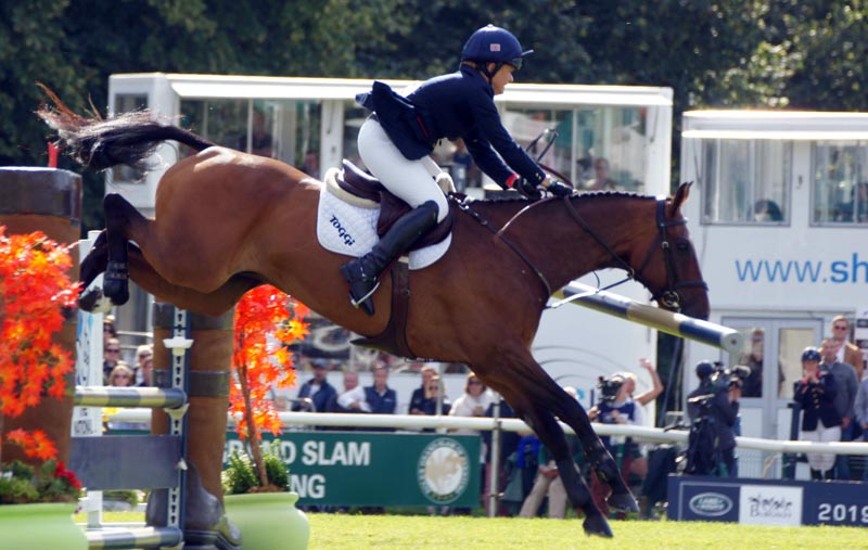 Pippa Funnell and MGH Grafton Street took a rail but kept their lead to win Burghley.