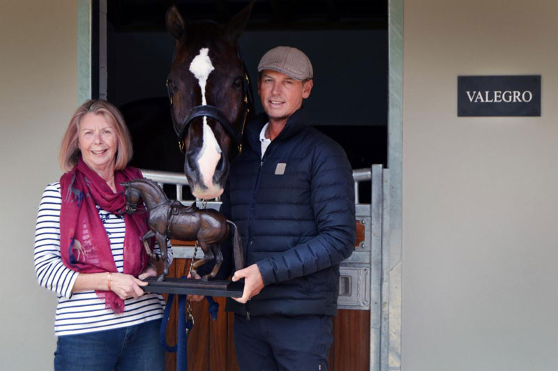 Valegro with two of his owners, Anne Barrott and Carl Hester, and one of the limited-edition bronze miniature models.