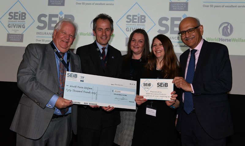 From left, Barry Fehler, Suzy Middleton and Bipin Thaker of SEIB present the 2019 SEIB Charity Grant to Roly Owers and Emma Williams of World Horse Welfare.
