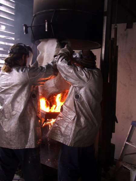 Heat is used to melt the wax and drain it from one of the ceramic shells, which would then be poured in bronze.