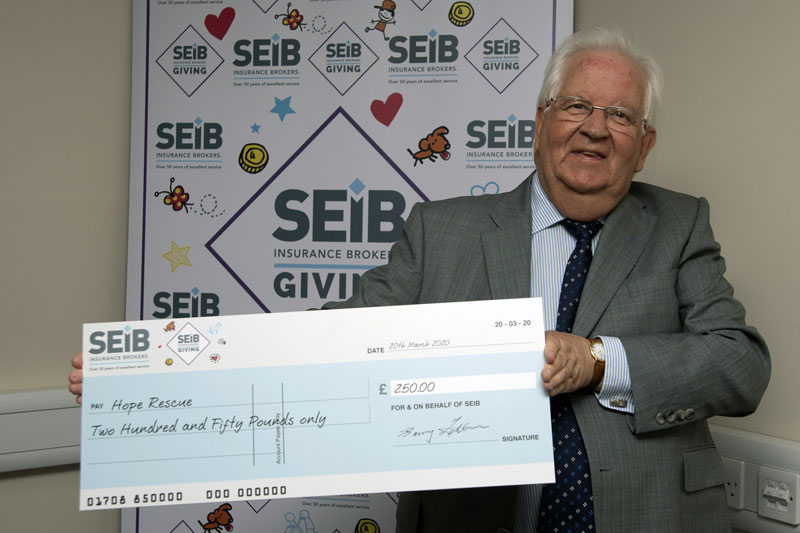SEIB founder Barry Fehler with the cheque for canine charity Hope Rescue.
