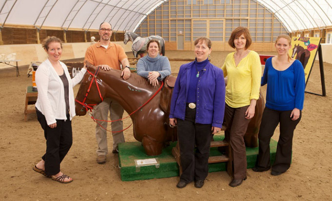 "The Equine Guelph Team gather around ""Shorty Legs"". Equine Guelph has received the Equestrian Canada Health and Welfare Award for 2019."
