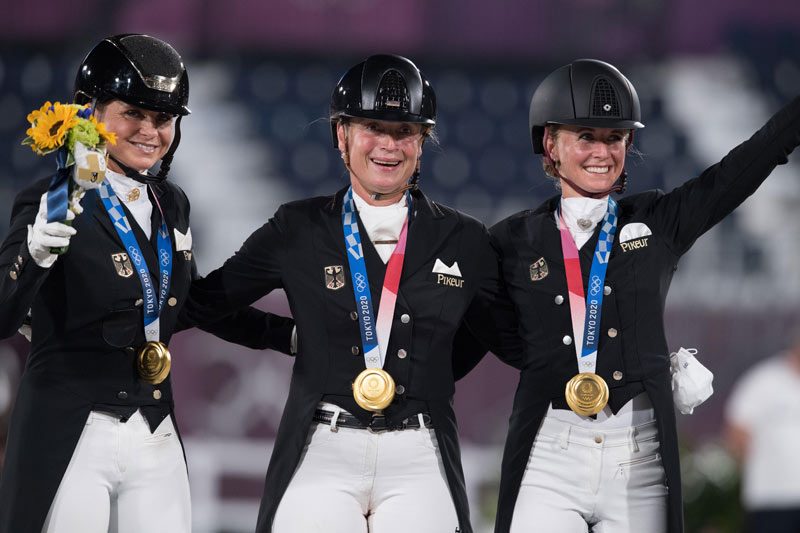 Germany's Dorothee Schneider, Isabell Werth and Jessica von Bredow-Werndl celebrating Dressage team gold at the Tokyo 2020 Olympic Games in Baji Koen Equestrian Park on Tuesday.