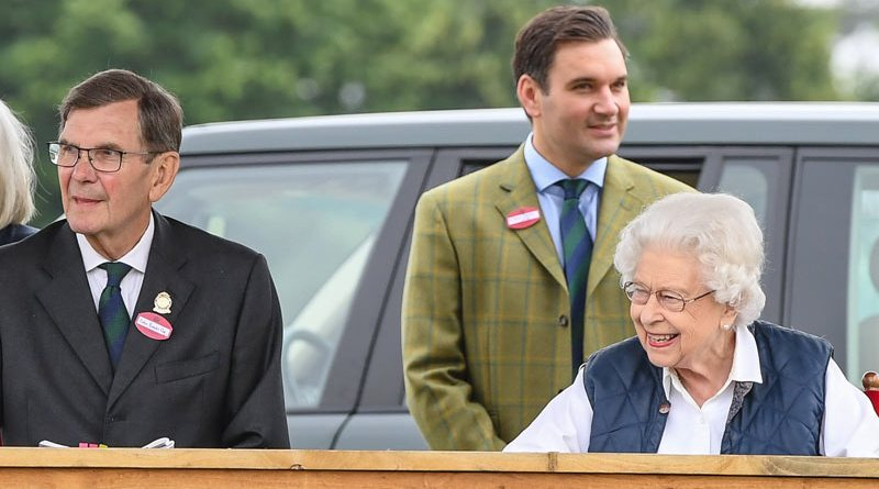 Queen Elizabeth II watches her horses in the Mountain and Moorland classes on Friday with Colin Brooks Esq, chairman of the Royal Windsor Horse Show.
