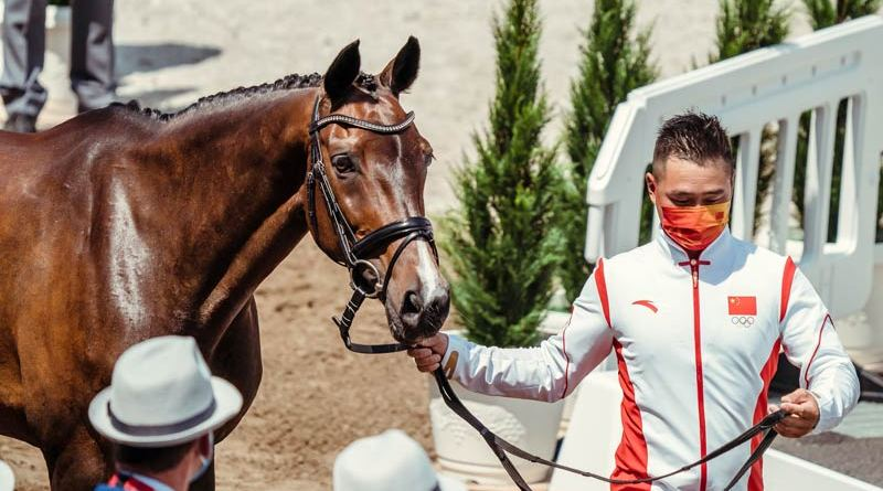 Yingfeng Bao and Flandia 2 at the first horse inspection. They are part of China's first eventing team at an Olympic Games.