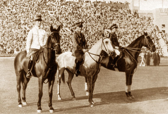 The individual Jumping medallists at the Los Angeles Olympics in 1932: Gold went to Takeichi Nishi (JPN), pictured at right with Uranus, silver to Harry D. Chamberlin (USA) riding Show Girl and bronze to Clarence von Rosen (SWE) on Empire.