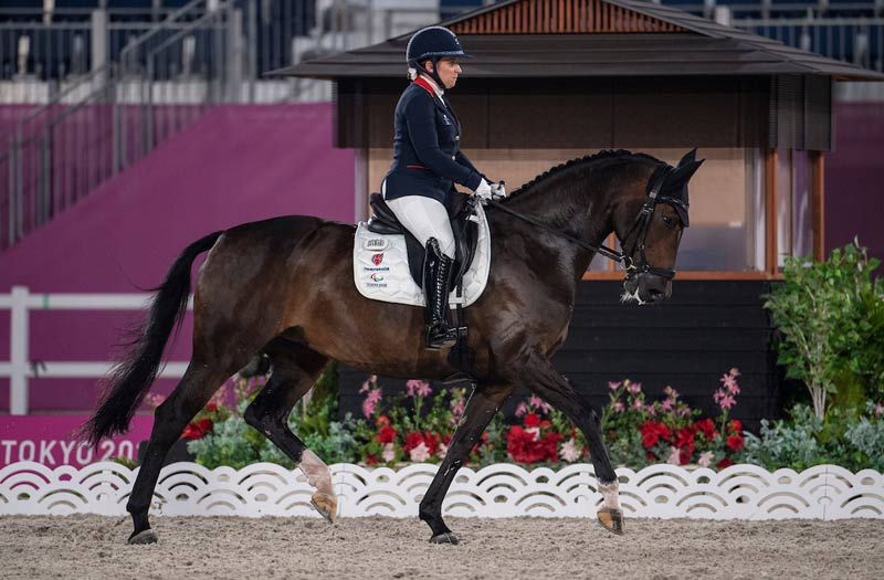 """Grade 3 rider Natasha Baker (GBR) riding Keystone Dawn Chorus: """"When you see my legs moving, that's not me. It's a completely involuntary movement."""""""