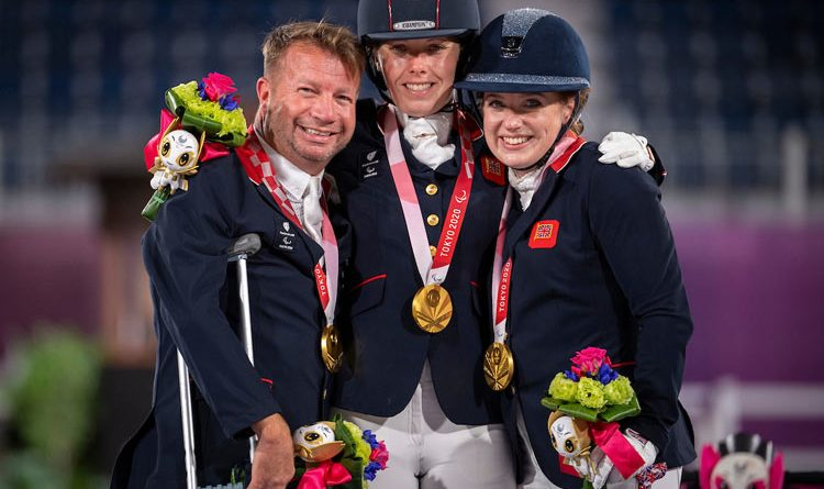 Great Britain's Raralympic tean gold medalists, from left, Lee Pearson, Sophee Wells and Natasha Baker.
