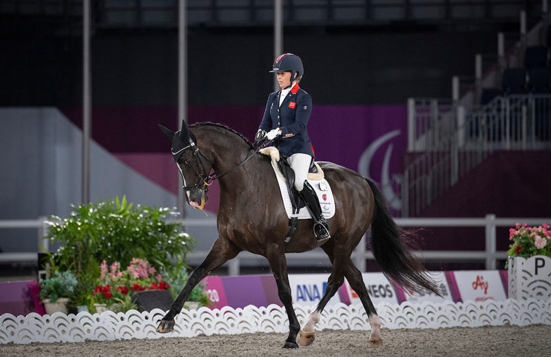 Britain's Sophie Wells and Don Cara M in her Grade 5 Dressage Team Test to Music at Tokyo 2020.