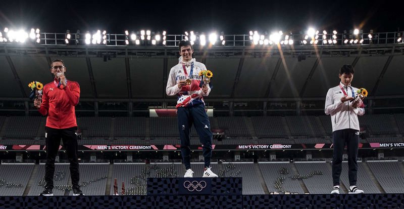 Joe Choong won gold for Britain in the men's modern pentathlon at Tokyo 2020, with Egypt's Ahmed Elgendy, left, taking the silver medal, and Jun Woongate from the Republic of Korea winning bronze.