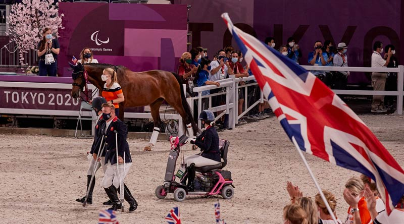 British para equestrian team members make their way to the podium for the award ceremony during the Tokyo 2020 Paralympics.