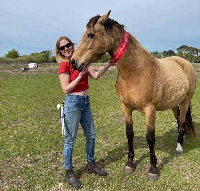 Laura Kelmere and her horse, Pluto, at home after their very first distance ride.