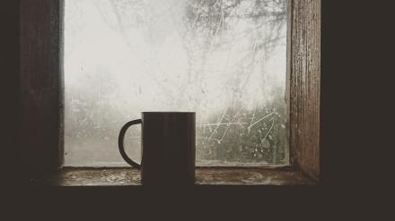 a silhouette of a cup by the frosty window