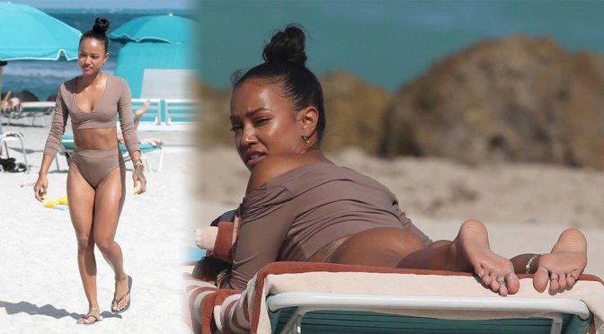 Karrueche Tran wearing a tankini on a beach in Miami