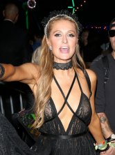 Paris Hilton exposing her breasts going braless in sheer black top