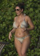 Kelly Brook's curvy body in bikini
