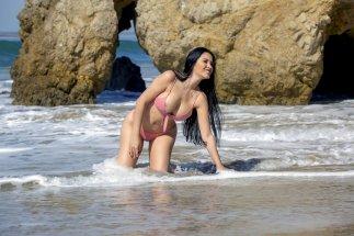 Claudia Alende having bikini malfunction exposing her nipples at beach in Los Angeles