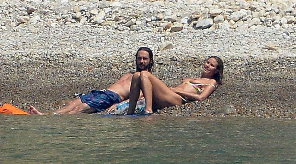 Heidi Klum - Bikini Topless Candids in Italy