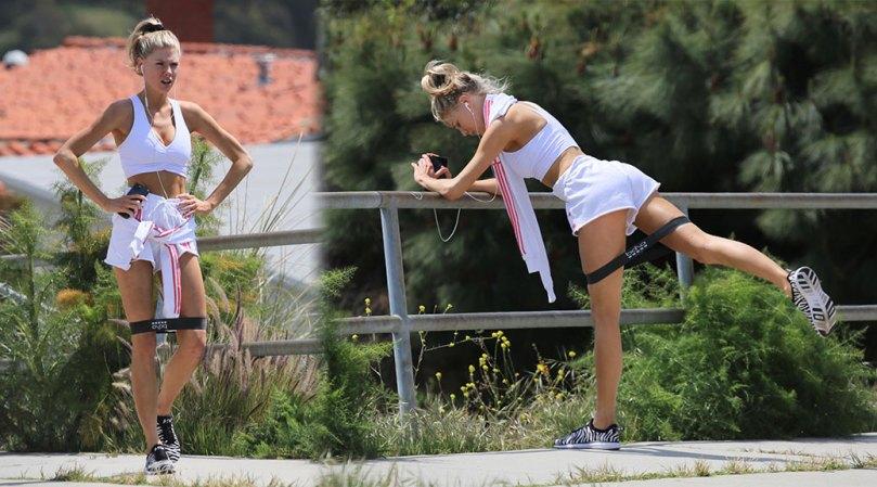 Charlotte Mckinney Sexy Legs In Shorts