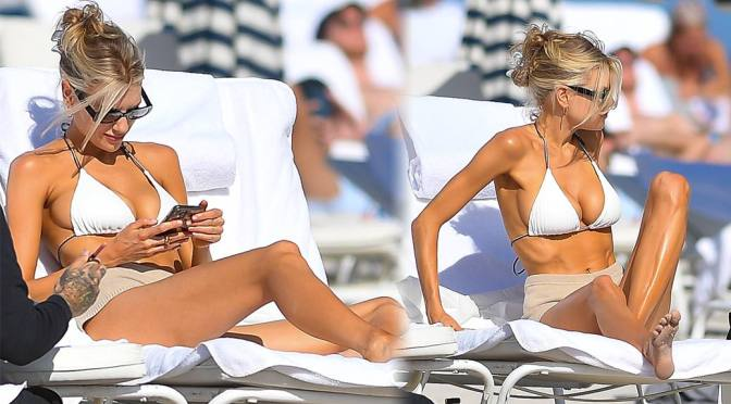 Charlotte McKinney – Sexy Big Boobs in a White BIkini at the Beach in Miami