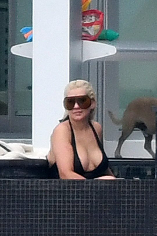 Exclusive: Christina Aguilera Wears A Black Swimsuit And Oversized Sunglasses As She Takes A Dip In The Pool Between Recording Sessions In Miami