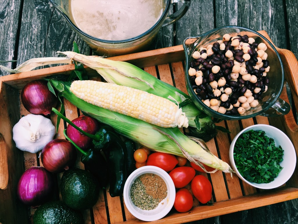 Fresh sweet corn, peppers, onions along with beans and tomatoes make this a bowl full of health...