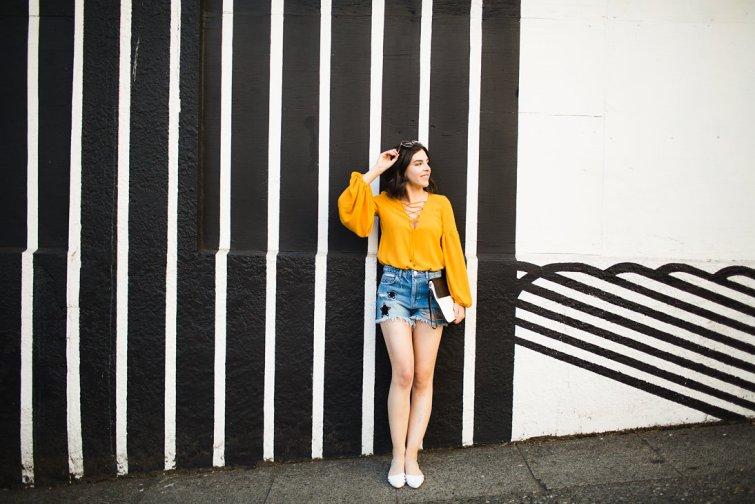 Fashion blogger denim shorts and lace up bodysuit