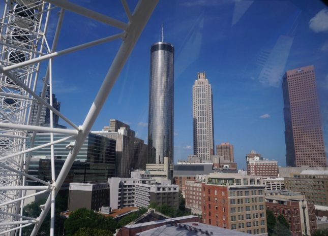 Riding the SkyView is a fantastic way to spend a day in Atlanta as evidenced by a view of downtown with a clear blue sky in the background.