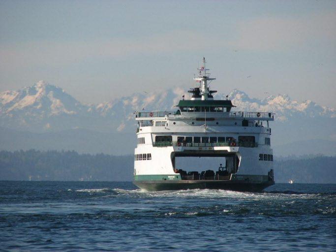 Ferry cruising the Washington Sound with snow-capped mountains in background.