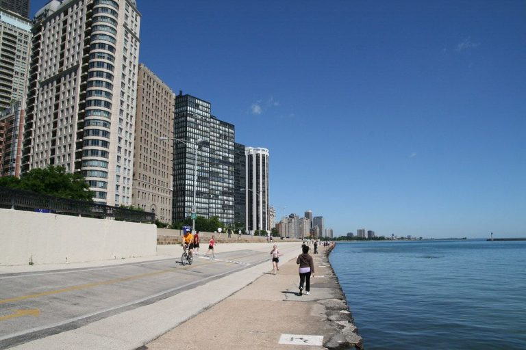 Walkers, joggers and bicyclists line the Chicago lakefront path.