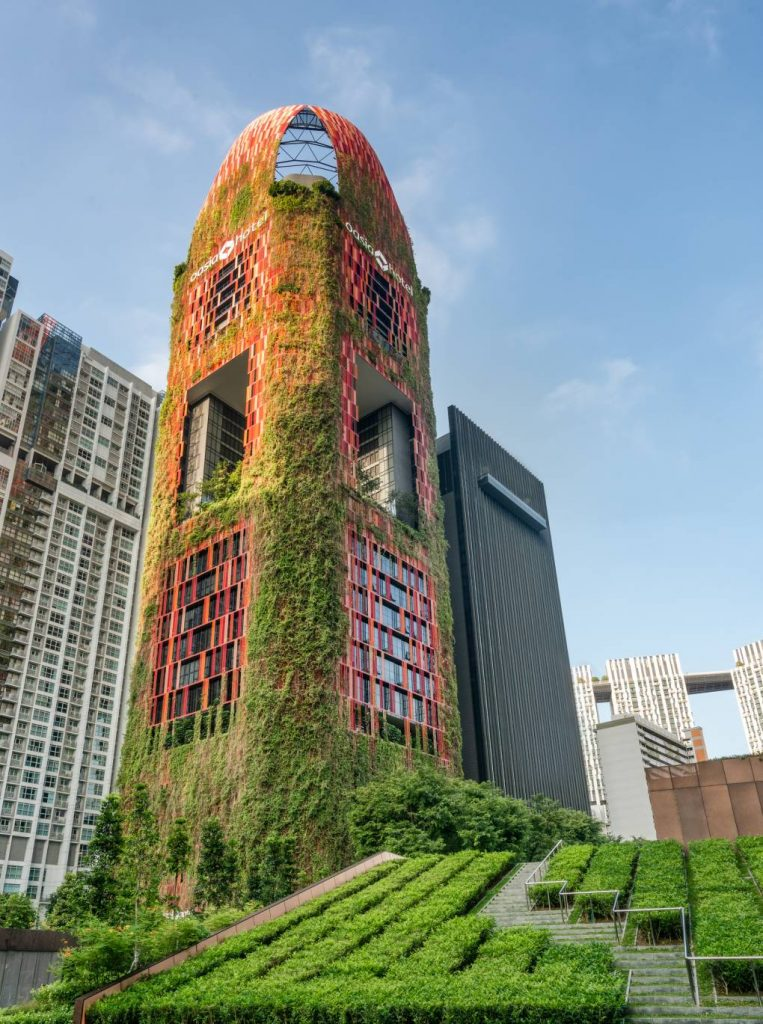 Vegetation lines the prominent Oasia Hotel Downtown in Singapore.