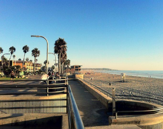 Serene Pacific Beach under clear blue skies in San Diego.