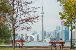 How to spend a day in Toronto: CN Tower Skyline from Toronto Island on sunny fall afternoon.