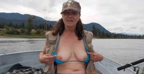 Average fishing girl showing off her tits while fishing
