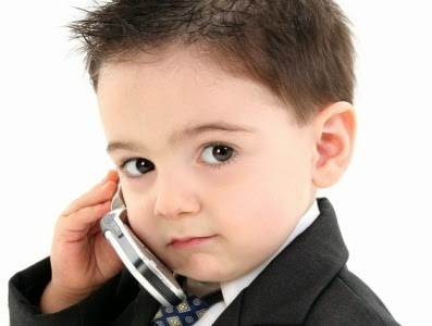 da32341f1 Adorable Baby Boy in Suit on Cellphone - Hot Magazine