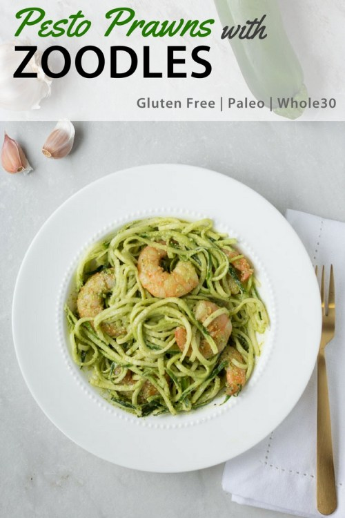 These Pesto Prawns with Zoodles make for an easy and healthy weeknight dinner recipe. Keeping the zucchini noodles raw helps the pasta stay fresh and not soggy. It's a naturally gluten free dish, and if you make it with compliant pesto it's also paleo and Whole 30. #pesto #shrimp #zucchininoodles #glutenfree #paleo #whole30