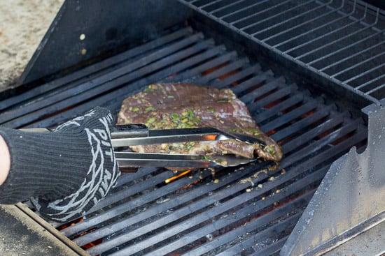 gluten free flank steak going on a grill