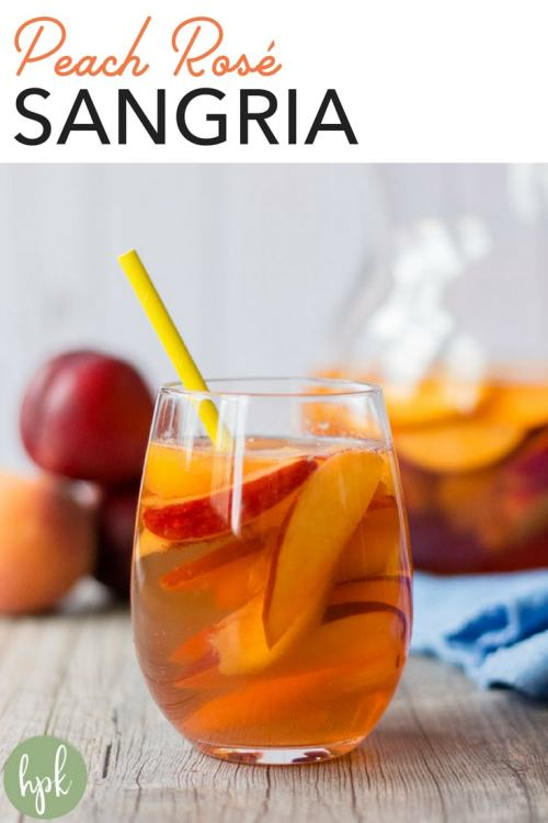 This Peach Rose Sangria recipe is perfect for spring, summer, or even warm fall weather. It uses both peaches and nectarines with just a little bit of sugar, plus grapefruit sparkling water for bubbles. It's an simple and easy drink option for a crowd, so add it to the menu for your next gathering! #sangria #peach #rose #drinks #glutenfree