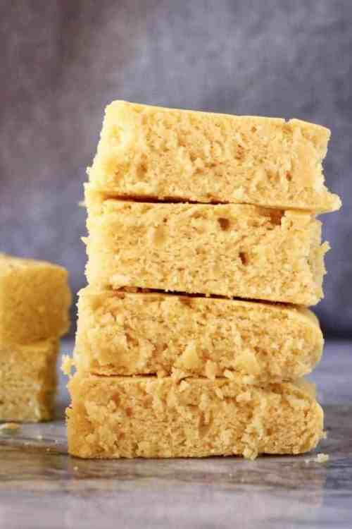 cornbread squares stacked on top of each other with a gray background