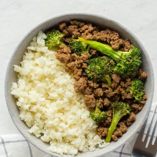 top down shot of paleo beef and broccoli stir fry in a gray bowl