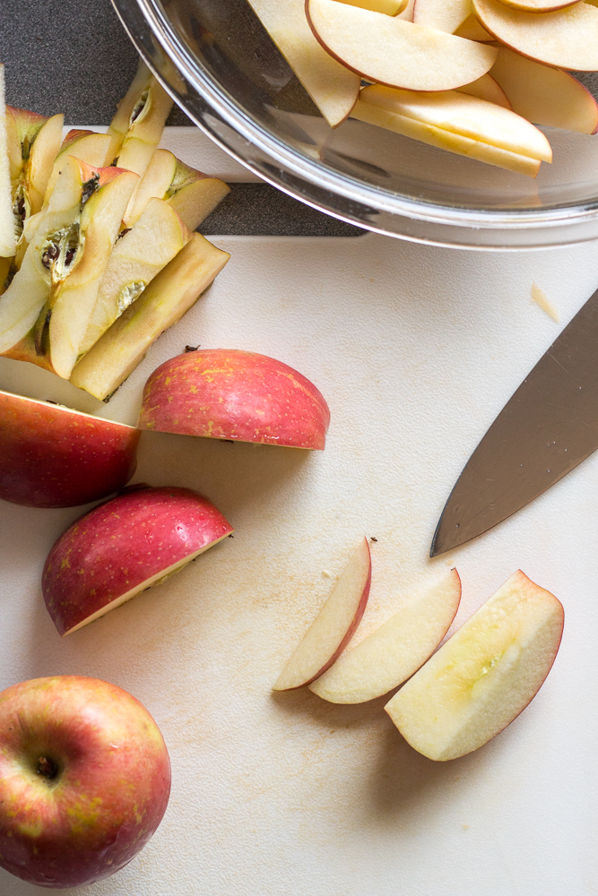 top down view of apples being cut into slices