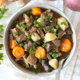 top down shot of a bowl of instant pot beef stew