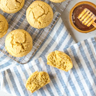 muffins on a towel and wire rack with honey aside
