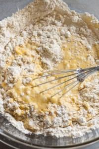 whisking together cornbread ingredients